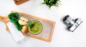 produce on cutting board, camera, and plant | juicing during pregnancy