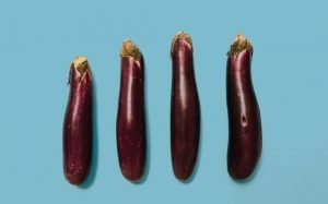 4 eggplants on blue background | eggplants during pregnancy